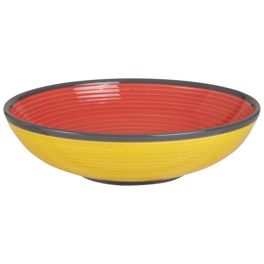 Assiette creuse en faïence rouge et jaune