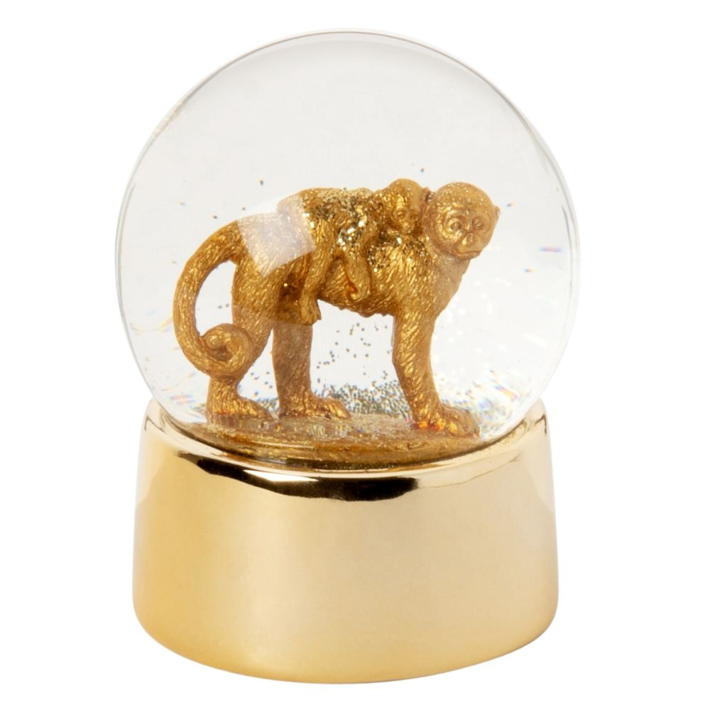 Boule à neige singes en céramique dorée