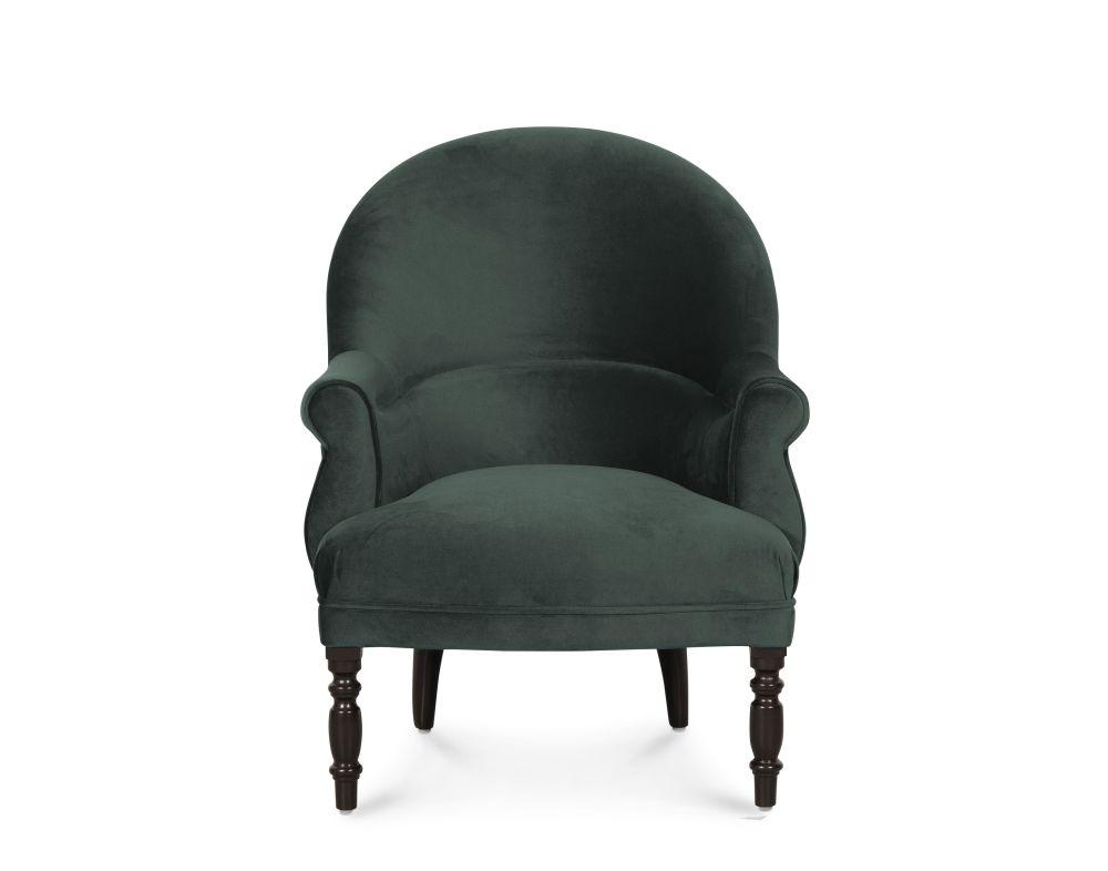 Fauteuil en velours vert et pieds en bouleau noir