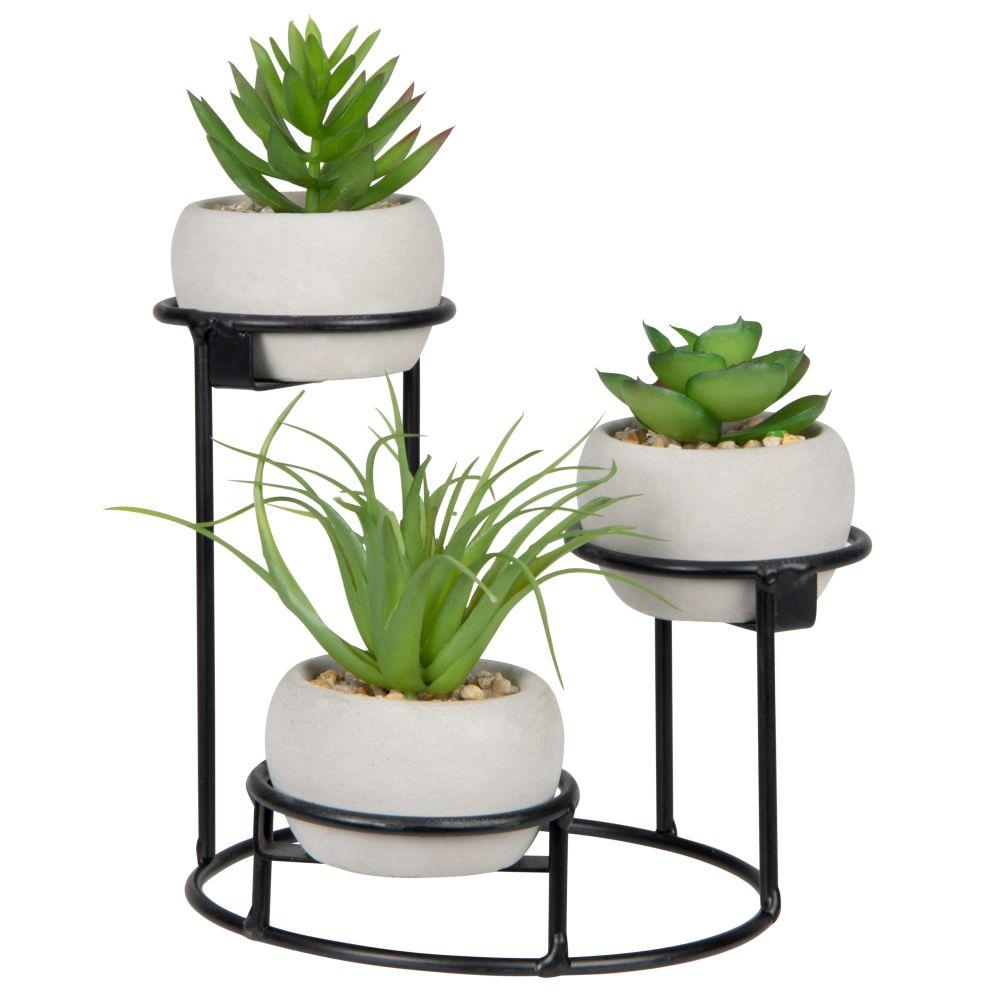 Plantes artificielles et triple pots blancs