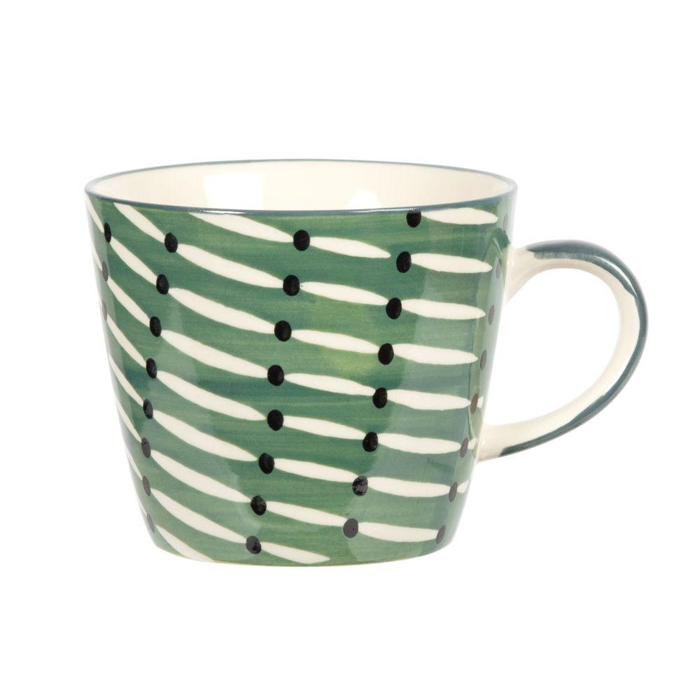Tasse en faïence verte, blanche et noire à motifs