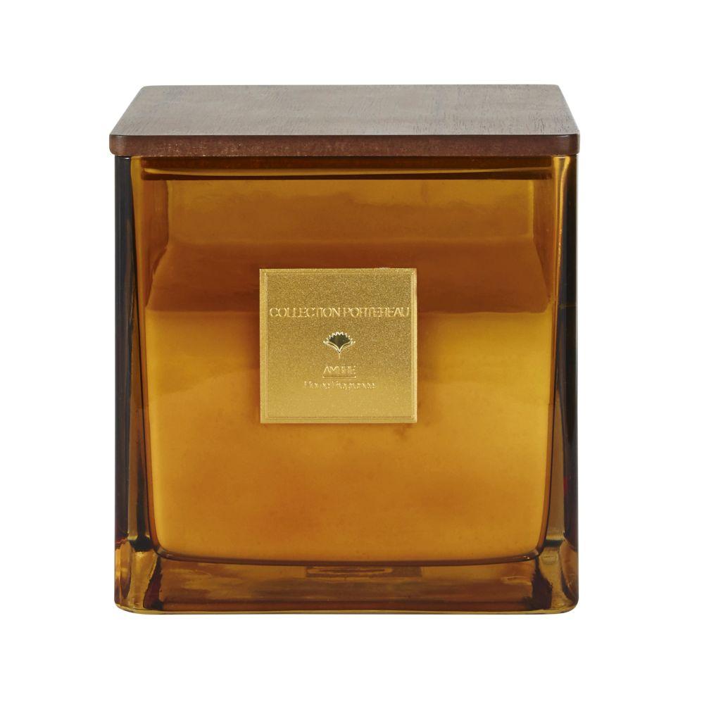 Vela perfumada en tarro de cristal tintado ambarino