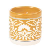 Bougie parfumée en céramique jaune motif floral blanc