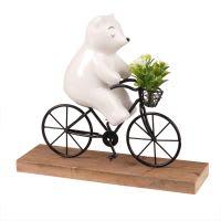 Statuette ours en vélo en porcelaine H18