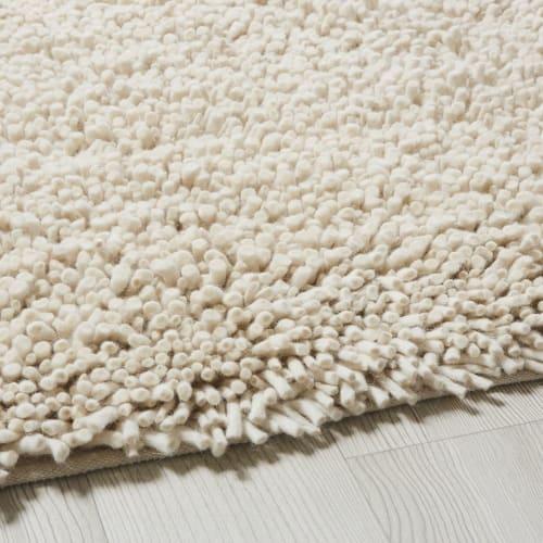 Alfombra de lana y algodón color crudo efecto shaggy 140x200
