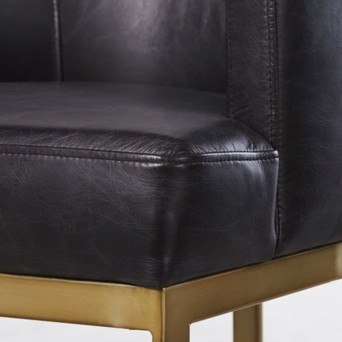 Fauteuil de bar en cuir noir et métal coloris laiton | Maisons du Monde