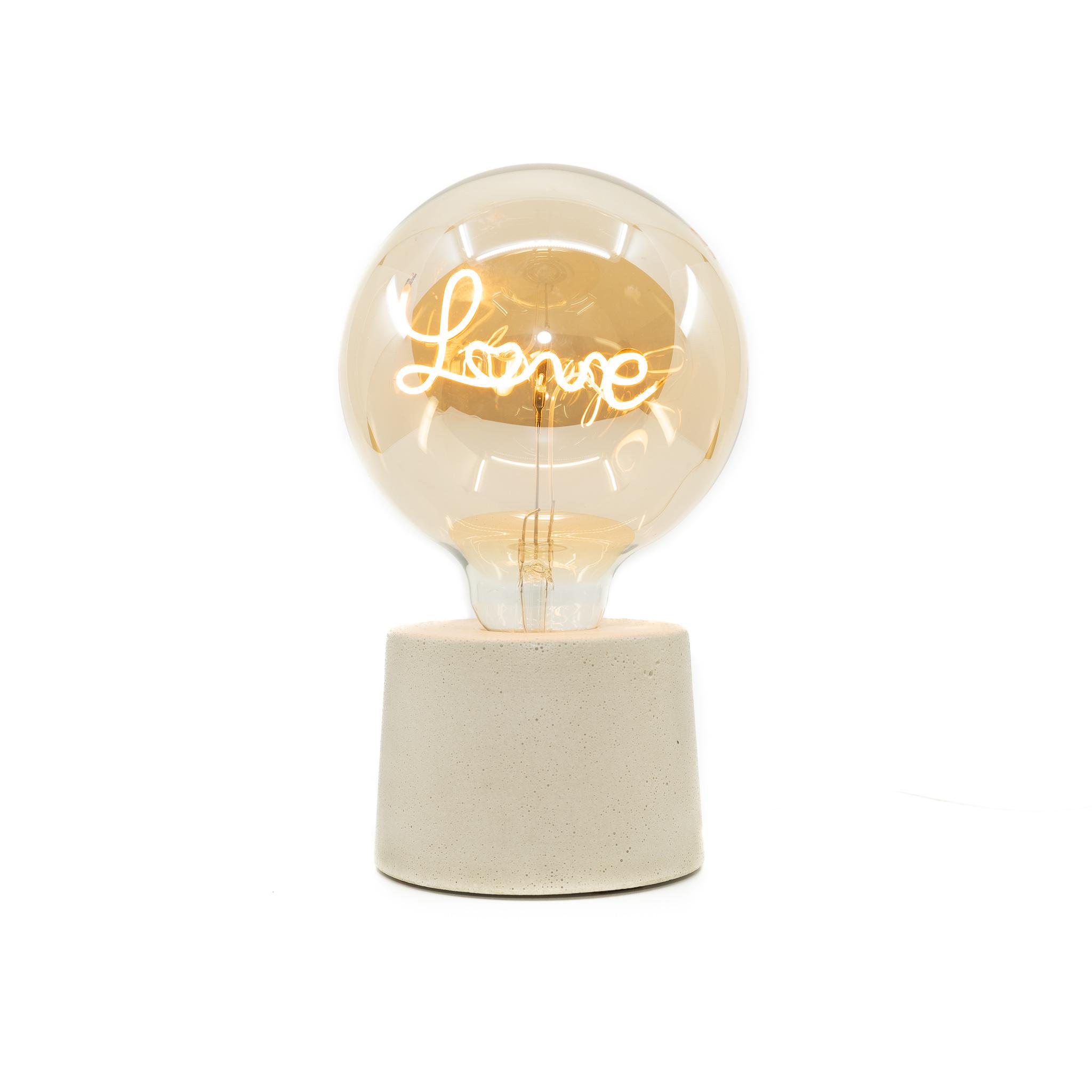 Lampe en béton beige et ampoule love