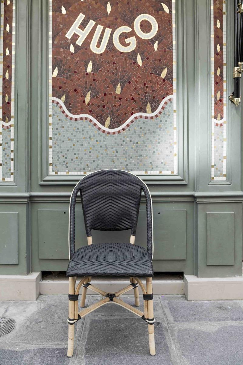 Chaise repas empilable en rotin et fibre synthétique noir