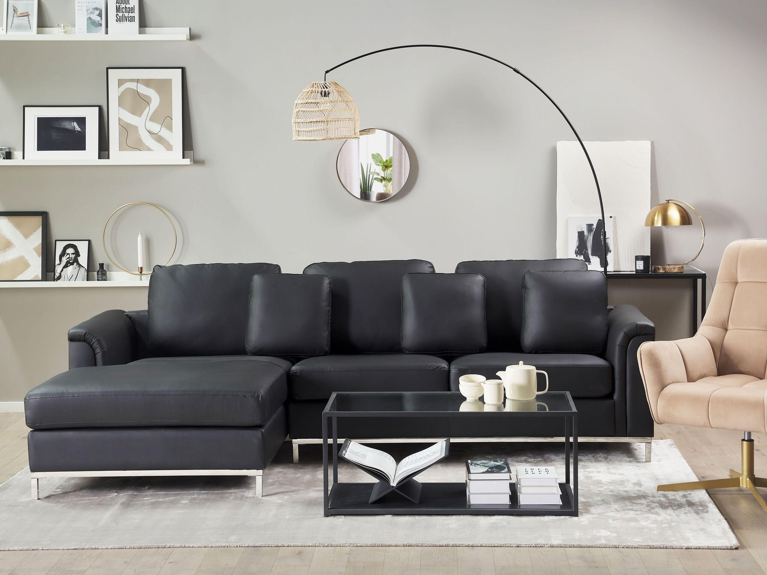 Canapé angle à droite 4 places en cuir noir avec pouf