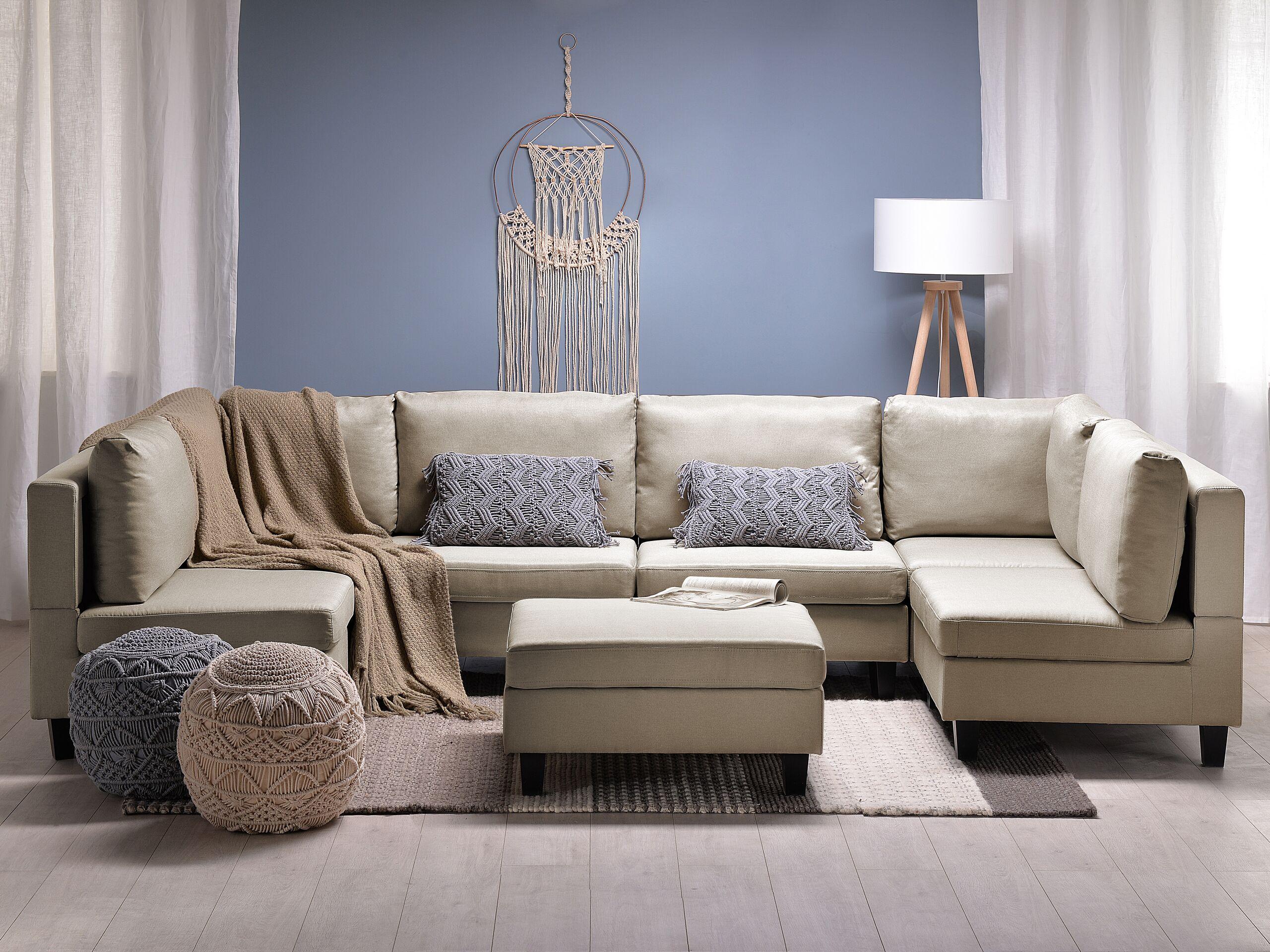 Canapé panoramique modulable 6 places en tissu beige avec pouf ottoman