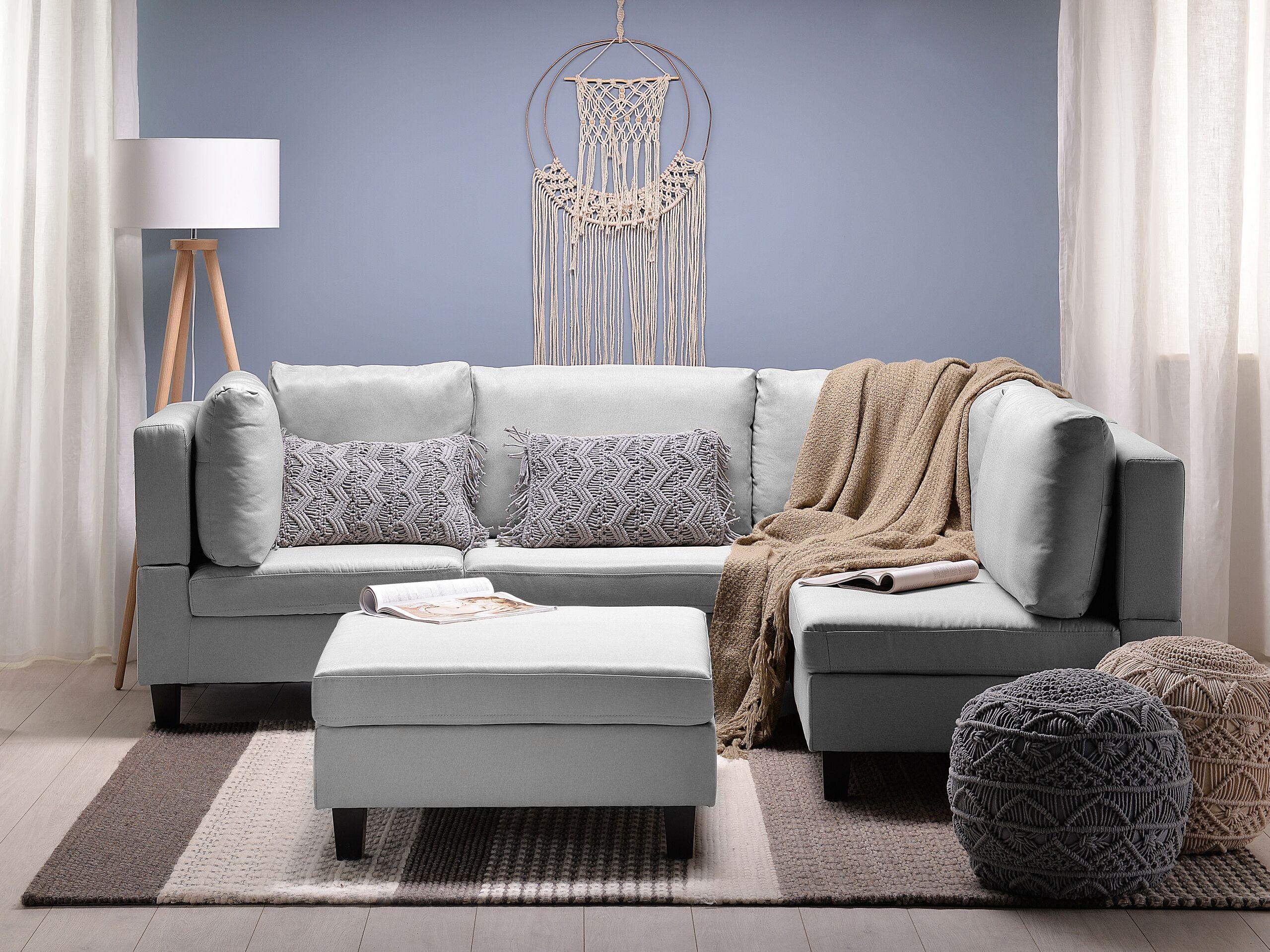 Canapé angle modulable 4 places en tissu gris clair avec pouf ottoman