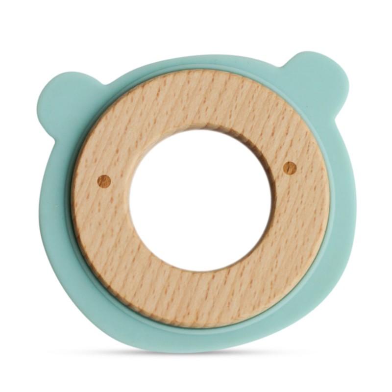 Anneau de dentition en bois et silicone bleu bébé