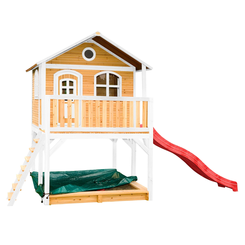 Maisonnette en bois brun et blanc sur pilotis avec toboggan rouge